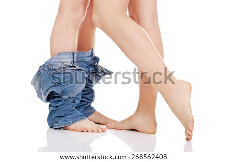 Young couple undressing each other. - stock photo