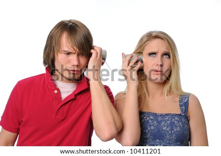 Young couple using a tin can phone and unable to communicate