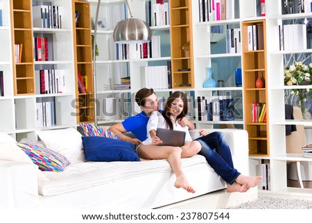 Young couple using digital tablet - stock photo