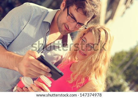 Young couple using smart phone. - stock photo