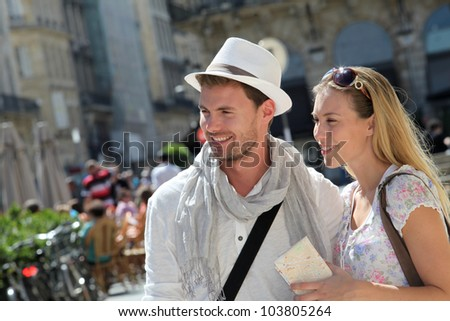 Young couple visiting city in summertime - stock photo