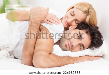 Young couple waking up in the morning. - stock photo