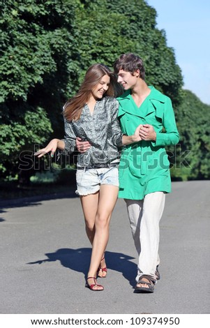Young couple walking on path in park - Outdoor