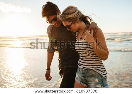 stock-photo-young-couple-walking-on-the-seashore-man-and-woman-in-love-on-the-beach-during-sunset-610937390 Outlines For Effective Yourrussianbride.net Systems Bierhocker
