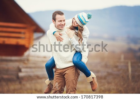 Young couple walking together while enjoying a day in the park - stock photo