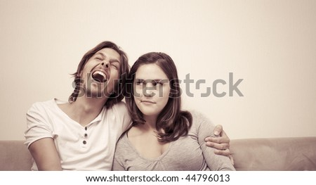 Young couple watch a movie and eat popcorn at home