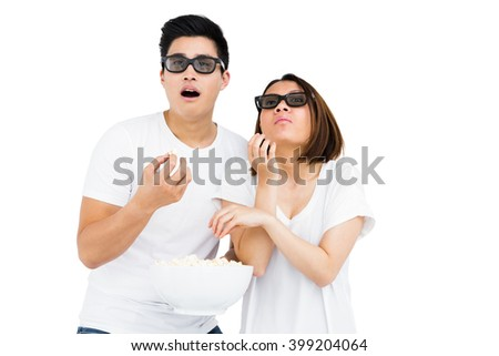 Young couple watching a 3d movie on white background - stock photo