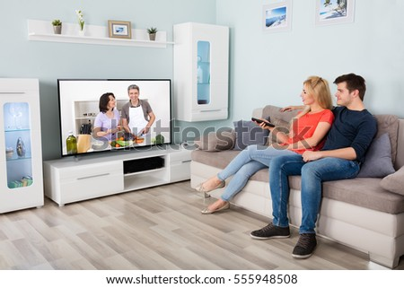 Living Room With Tv And People couple watching tv stock images, royalty-free images & vectors