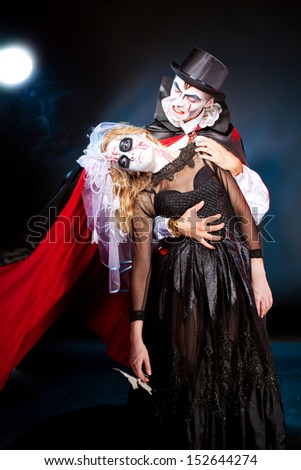 young couple wearing  as  vampire and  dead bride. Halloween - stock photo