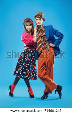 Young couple wearing colorful old-fashion clothes in pinup style. They can represent members of a youth counterculture Stilyagi existed from the late 1940s until the early 1960s in the Soviet Union