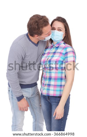 young couple wearing medical masks