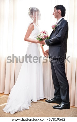 Young couple wedding. Soft bright colors. - stock photo