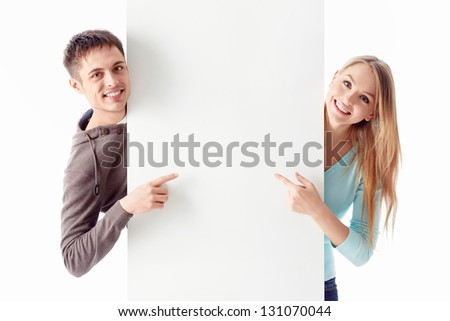 Young couple with a billboard
