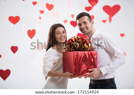 Young couple with a gift - stock photo