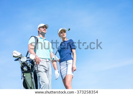 Young couple with a golf club