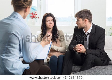 Young couple with a problem to consult a psychologist - stock photo