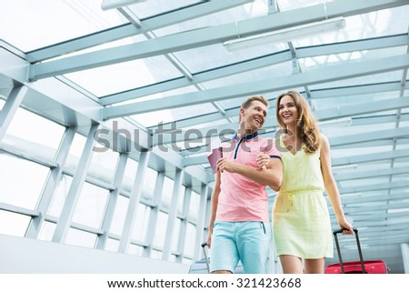 Young couple with a suitcase  - stock photo