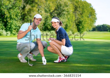 Young couple with ball - stock photo