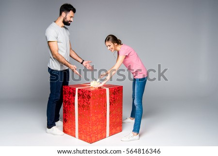 young couple big red gift box stock photo edit now 564816346