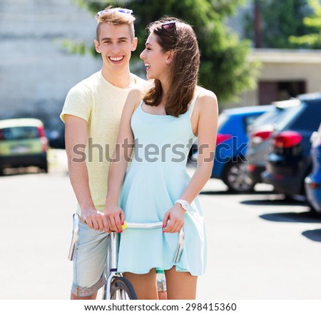 Young couple with bike  - stock photo