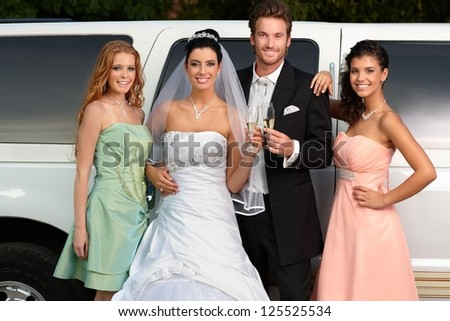 Young couple with bridesmaids on wedding-day. - stock photo