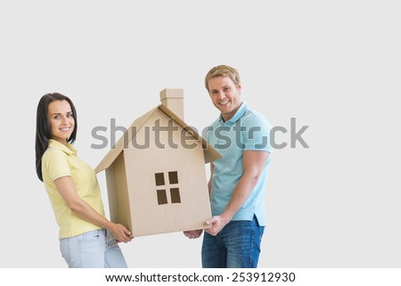 Young couple with cardboard sign - stock photo