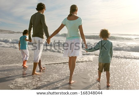 Young couple with children - stock photo