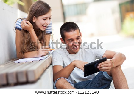 Young couple with digital tablet - stock photo