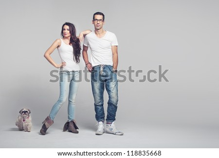 Young couple with dog - stock photo