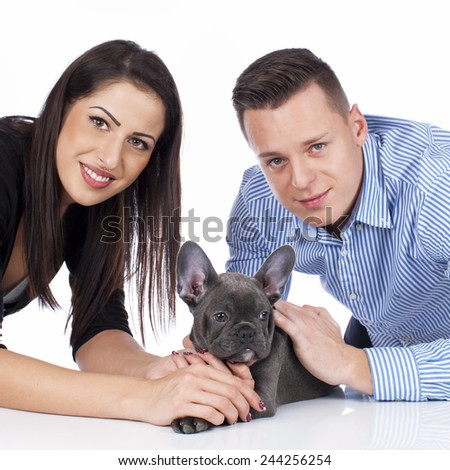 Young couple with French bulldog puppy