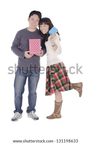 Young couple with gift over white background