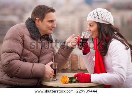 Young couple with glasses of hot wine - stock photo