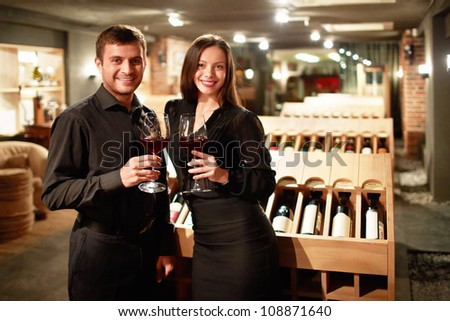 Young couple with glasses of wine - stock photo