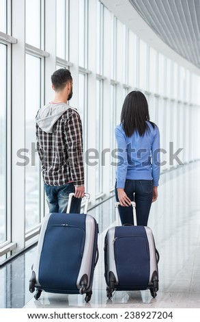 Young couple with luggage bags at airport are ready to flight. - stock photo