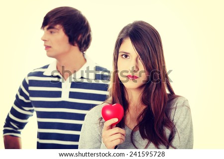 Young couple with red heart. - stock photo
