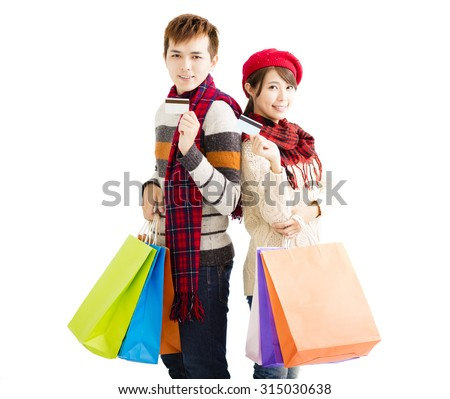 young couple with shopping bags and credit card
