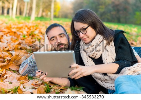 Young couple with tablet computer