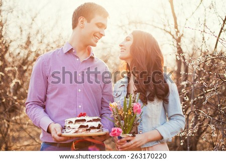 young couple with tasty cake - stock photo
