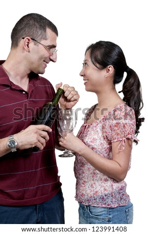 Young couple with wine and wine glasses - stock photo