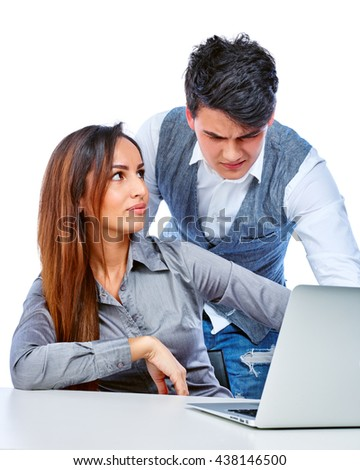 Young couple work with laptop. Isolated on white background