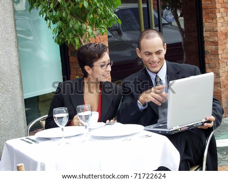 Young couple working in a cafe using a laptop. - stock photo