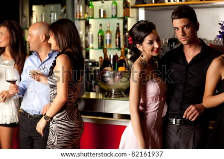 young couples at bar counter having fun - stock photo