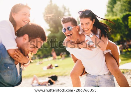 Young couples having fun on the beach