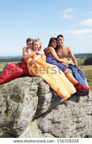 Young Couples On Camping Trip In Countryside - stock photo