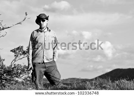 Young cowboy - black and white - stock photo
