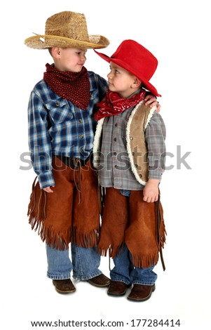 young cowboy brothers looking at each other
