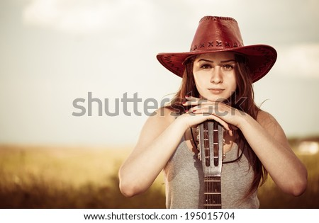 young cowgirl portrait in hat - stock photo