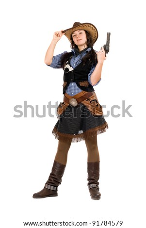 Young cowgirl with a gun in hands. Isolated on white