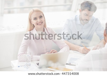 Young coworkers having brainstorming session in modern office - stock photo