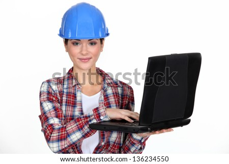 young craftswoman with laptop - stock photo